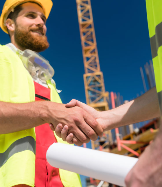 cheerful-worker-shaking-the-hand-of-an-architect-at-the-beginning-of-a-new-project